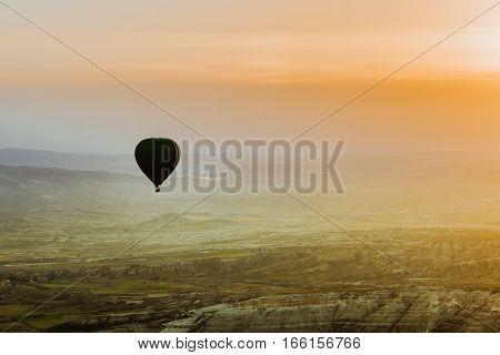 Hot air balloon flying over Cappadocia region, Turkey