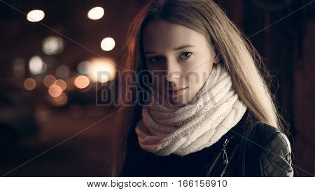 Art portrait of a beautiful girl. gorgeous brunette girl, portrait in night city lights.