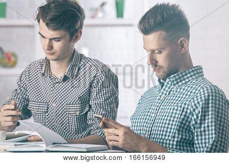 Handsome Gentlemen Using Cellphone