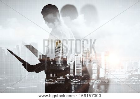 Businessperson with document on abstract city background. Double exposure