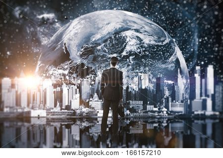 Thoughtful man looking at abstract nighttime cityscape in space. Double exposure. Research concept.