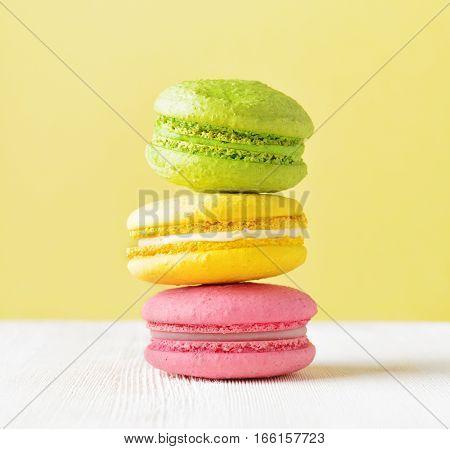 Macaron On White Wooden Table