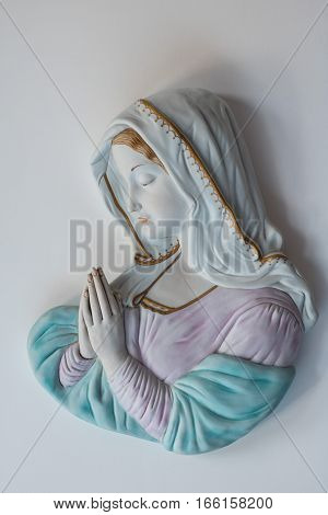 A statue of Madonna with clasped hands