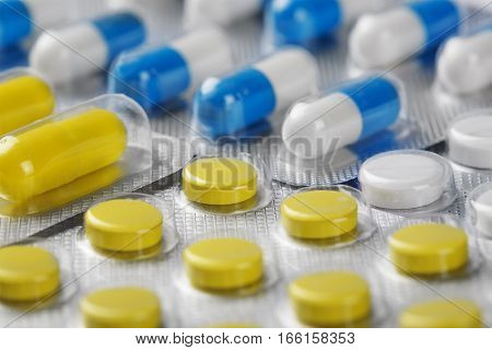 Boxes With Yellow Medical Pills And Blue-white Pills