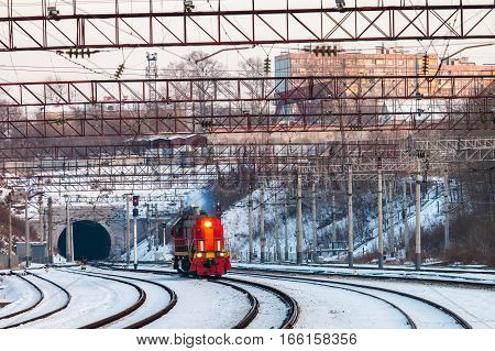 KHABAROVSK RUSSIA - JANUARY 06 2017: Red diesel engine shunting locomotive on the railroad