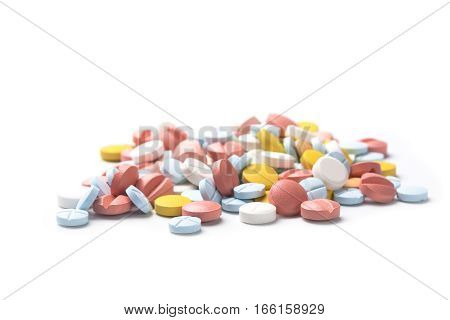 Heap Of Colored Medicine Pills On Light Background