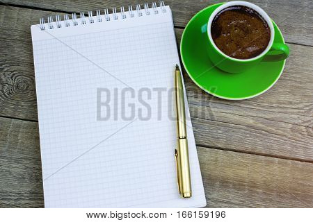 Blank Paper With Pen And Coffee Cup On Wood Table. Close-up