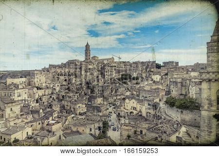 panoramic view of typical stones (Sassi di Matera) and church of Matera under blue sky old vintage retro effect