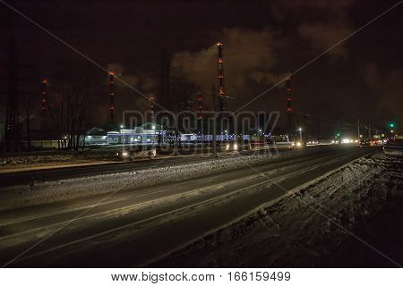 Night road in the industrial area .