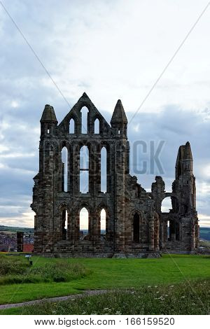 Whitby on the North Yorkshire coast England. The ruins of Whitby Abbey on the East Cliff home of Caedmon the earliest recognized English poet lived.