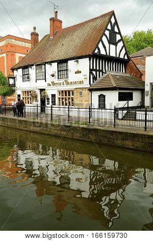 LINCOLN, UK - JULY 1, 2016: The Witch & Wardrobe - a traditional pub housed in a medieval building at the Witham river near the Waterside Shopping Centre.
