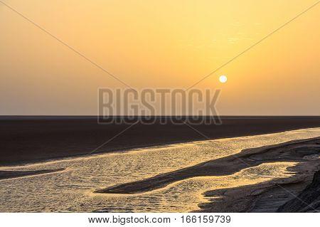 Sunset on shores of Chott el Djerid, salt lake in Tunisia