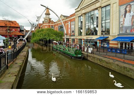 LINCOLN, UK - JULY 1, 2016: Waterside shopping center on the fossdyke canal on the Witham river with barge & empowerment art. It is situated in the heart of the historic city of Lincoln.