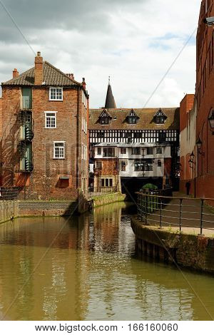 The High Bridge and The Glory Hole with its medieval timber framed building on it in Lincoln, England. It is the oldest bridge in the United Kingdom built about 1160 AD