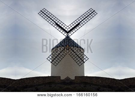 They are not mills, they are giants, phrase of Don Quixote of La Mancha when attacking wind mills,Geometric and surreal composition of Windmill, Cervantes,
