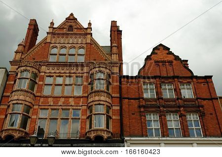 Old red brick buildings on High straat in Lincoln Lincolnshire England.