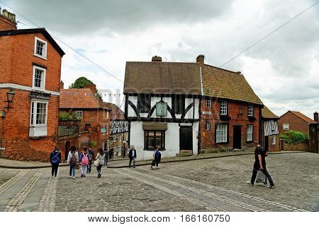 LINCOLN, UK - JULY 1, 2016: Steep Hill a popular tourist street in the historic city of Lincoln. In 2011 it was named