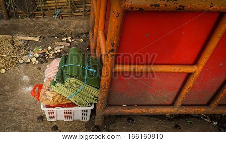 Shopping vegetables including a bundle of banana leaf in white plastic box photo taken in Jakarta Indonesia java
