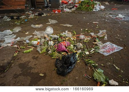 vegetables trash littered on the ground in traditional market photo taken in Jakarta Indonesia java