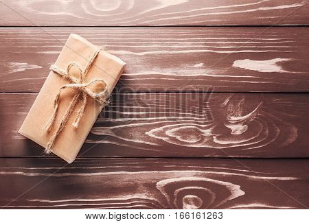 One Gift On The Old Wooden Background