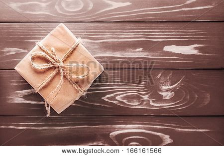 One Small Gift On The Old Wooden Background