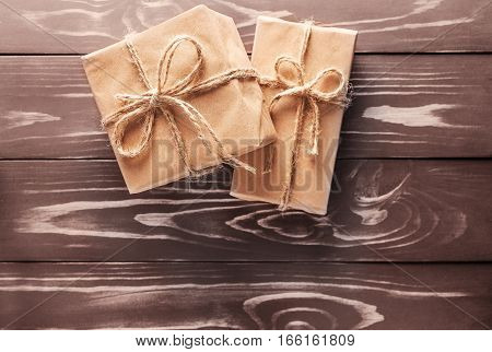 Two Gift On The Old Wooden Background