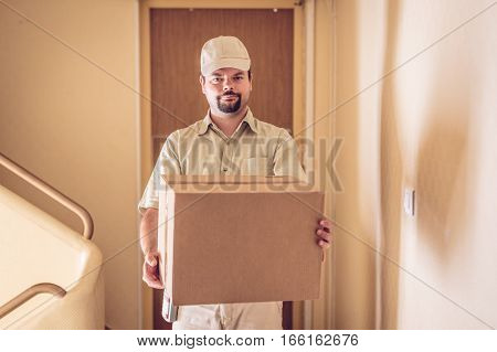 Messenger delivering a parcel to your door