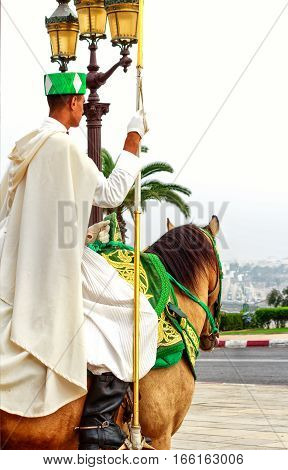 RABAT, MOROCCO-OCTOBER 02, 2014: Royal mounted guard on Arab horse at the Hassan Tower and Mausoleum of Mohammed V