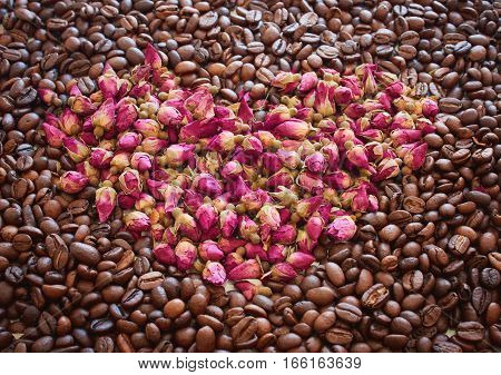 I heart you made of flowers, leaves, berries and coffe beans.