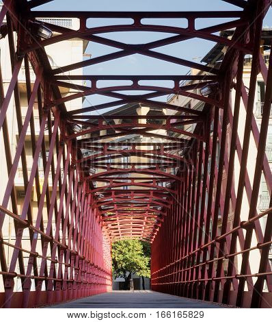Girona (Gerona Catalunya Spain): red bridge over the Onyant river