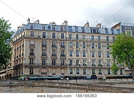 Typical design of Parisian architecture, Old building near the Seine river bank, France