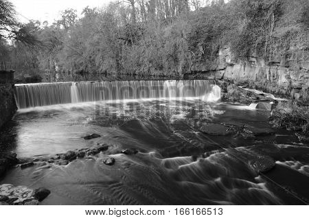 A view of a waterfall on the river Almond near Crammond