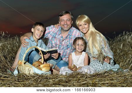 family in the meadow at night, mother, father, daughter and son