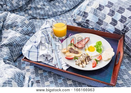 Valentine's day breakfast - bacon, egg, pancake, banana copy space