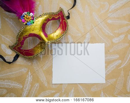 Colorful mardi gras or carnivale mask on a gold background. Venetian masks.