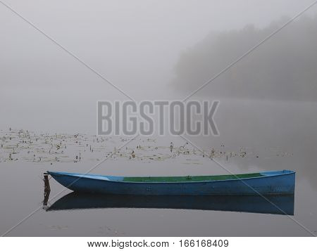 boat on the river in the morning mist