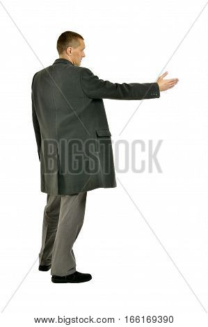 Handsome Man in coat pointing on a white background