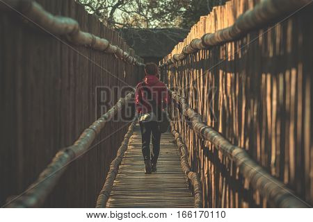 Woman Walking In Wooden Narrow Walkway. Protection For Tourists In Nature And Wildlife Reserve In So