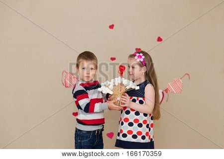 Beautiful Boy And Girl On The Background Of Hearts