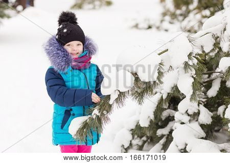 Portrait Of A Girl In The Winter Forest