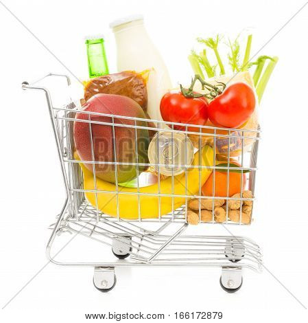 Studio shot of shopping cart with groceries, side view