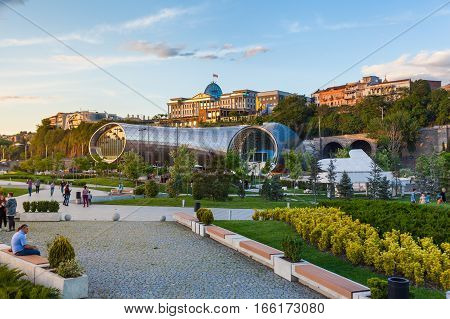 Tbilisi, Georgia - May 4, 2014: Beautiful view Of Concert Music Theatre Exhibition Hall In Summer Rike Park on the Sunset, Tbilisi, Georgia. Beautiful new park in the city center.