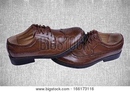 men's  fashion shoes brown isolated on abstract background.