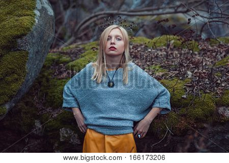 Portrait of a girl in the fall outdoor background rock.