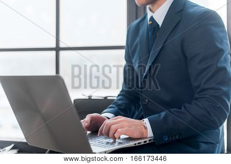 Businessman working and using laptop in office