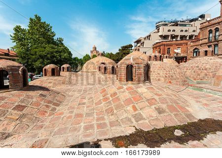 Abanotubani - ancient district of Tbilisi, Georgia, known for its sulfuric baths. The roof with dome of red brick of steam rooms.