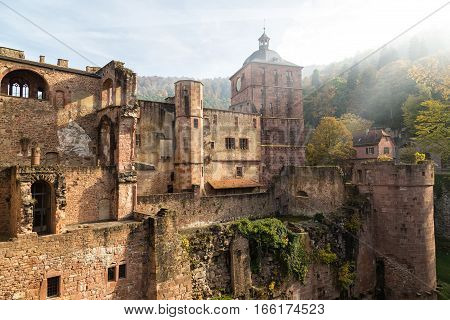 Ancient medieval castle - fort (Heidelberger Schloss). Mysterious ruins in sunlight. Heidelberg. Germany. Famous tourist destination