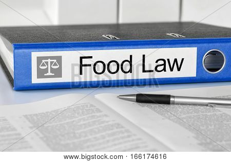 Blue Folder With The Label Food Law