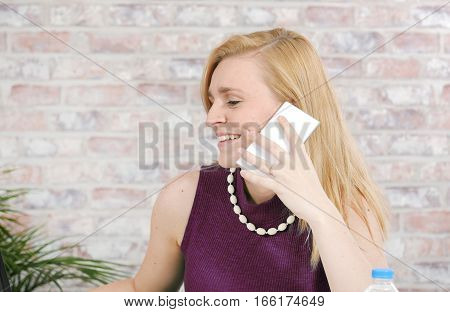 portrait of beautiful young businesswoman talking on phone