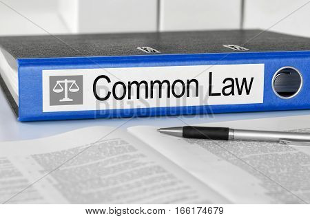 Blue Folder With The Label Common Law